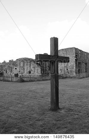 A wooden cross standing outside the ruins of Balmerino abbey