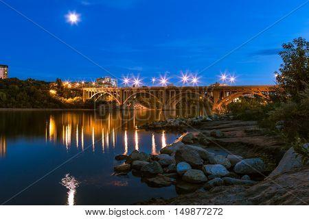 View of the Broadway Bridge in Saskatoon Saskatchewan on a calm summer evening.