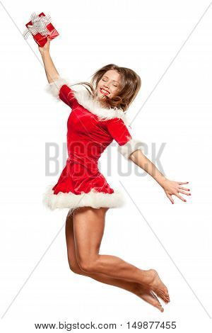 christmas, x-mas, winter, happiness concept - smiling woman in santa helper hat with  gift box, happiness jump for joy, isolated on White Background