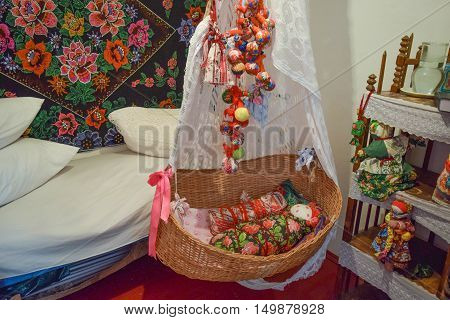 Cradle With Dolls In The Bedroom