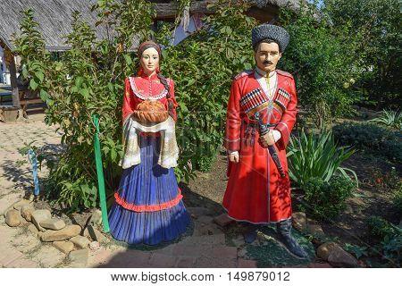 Statue Of Cossack And Cossack-girl.