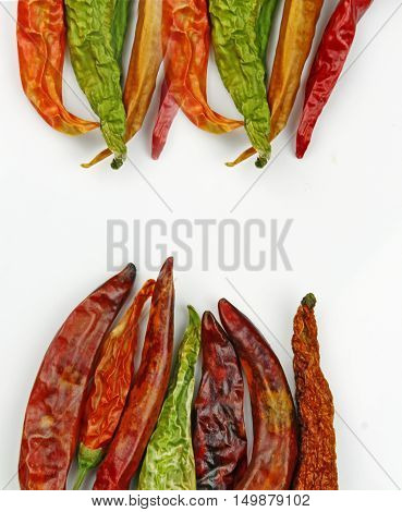 Red dried chili pepers on white background with copy space.