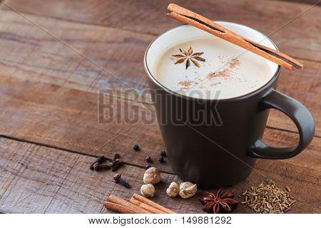 masala chai with spices. Cinnamon Stick Thai Cardamom Ginger Clove Star Anise Black Peppercorns Fennel Seeds Black Tea