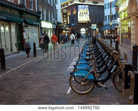 LONDON UK - JULY 192012: Bicycles for rent parking in London's SOHO district at evening