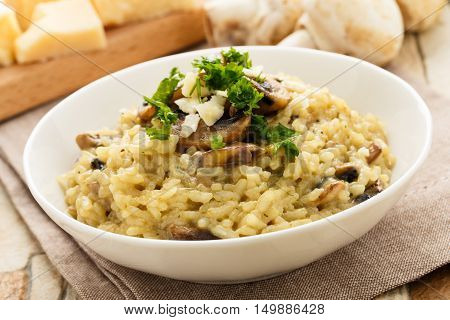risotto with mushrooms fresh herbs and parmesan cheese.