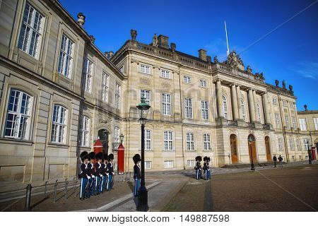 COPENHAGEN DENMARK - AUGUST 15 2016: Danish Royal Life Guards on the central plaza of Amalienborg palace home of the Danish Royal family in Copenhagen Denmark on August 15 2016.