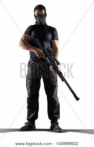man in mask black military uniform holding rifle isolated on white background