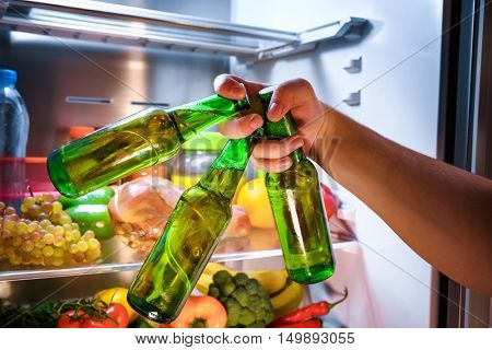 Man taking beer from a fridge