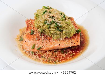 Grilled salmon fillet with avocado mash, close-up
