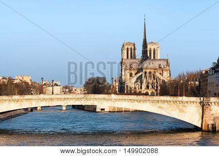 Notre-Dame de Paris and river Seine in morning light Paris France