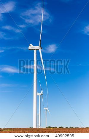 Wind turbines in a Kansas field side view