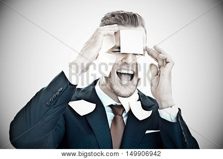 Screaming Businessman Completely Overwhelmed By Office Work,- Post-it Stickers All Over His Face..