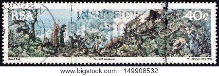 SOUTH AFRICA - CIRCA 1988: A stamp printed in South Africa issued for the 150th anniversary of Great Trek shows crossing the Drakensberg (tapestry by W. Coetzer), circa 1988.