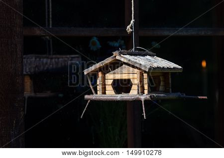 Handcrafted Log Cabin Birdhouse. Close-up