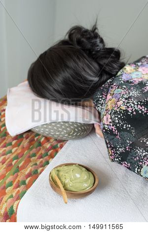 Massage series : Asian woman lying on massage bed in spa
