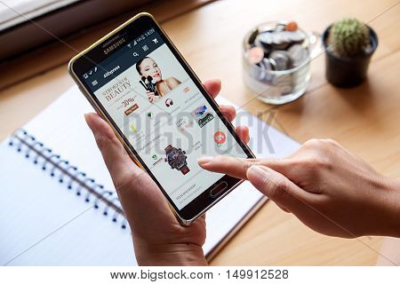 CHIANGMAI, THAILAND - OCT 13, 2016: Aliexpress app showing on Note 3 on the wooden desk. Aliexpress is one of popular e-commerce application launch in 2010