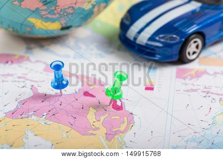 Road map Green push pin the location of destination by car on a map.
