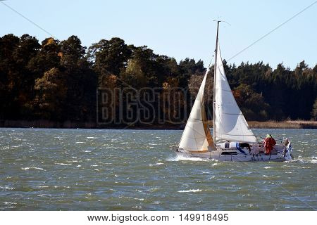 Sailboat in action on a windy sea.