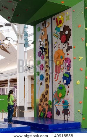 Moscow, Russia - August 30, 2016. The Childrens climbing wall in shopping complex Zelenopark