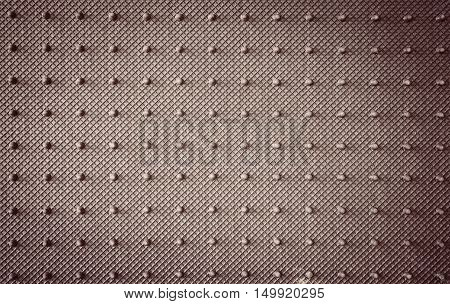 Back view of knobby car mat non slip rubber surface texture background with color filter effect