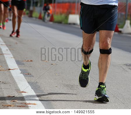 Athlete Runner During The Race With The Bandage