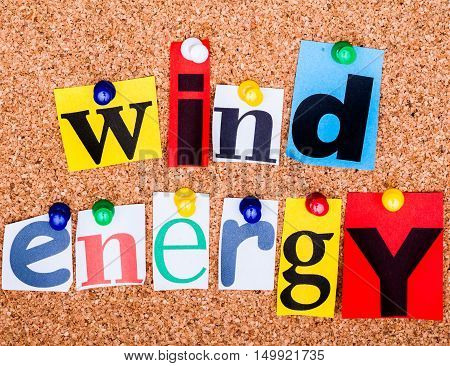 The Phrase Wind Energy In Cut Out Magazine Letters Pinned To A Cork Notice Board..