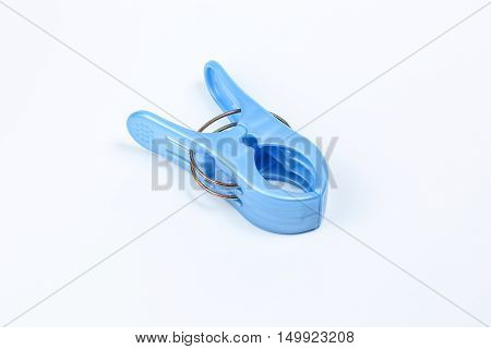 Blue plastic cloth pin clip on white background