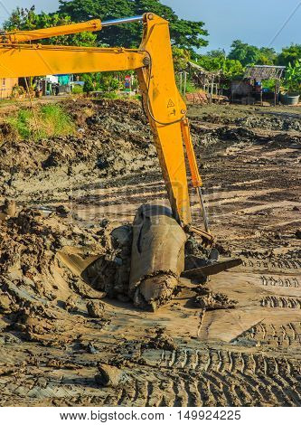excavator yellow. on a construction site against