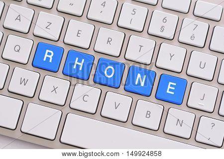 Rhone in blue on a white keyboard