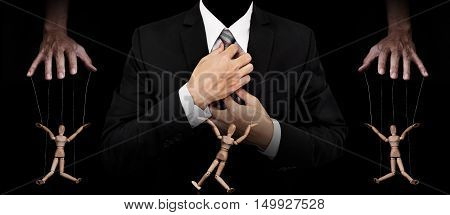 Businessman with wooden figure puppet, concept of business manipulation, panoramic image