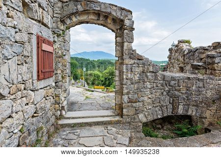 View thru the stone arch, historical building and beautiful landscape