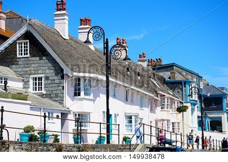 LYME REGIS, UNITED KINGDOM - JULY 18, 2016 - Buildings along the promenade with ammonite decorated streetlights Lyme Regis Dorset England UK Western Europe, July 18, 2016.