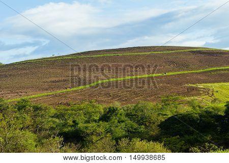 Countryside hillside fields plowed earth farming landscape