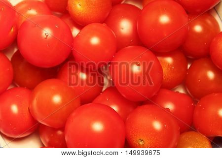 Many juicy Pachino tomatoes for sale in a market stall