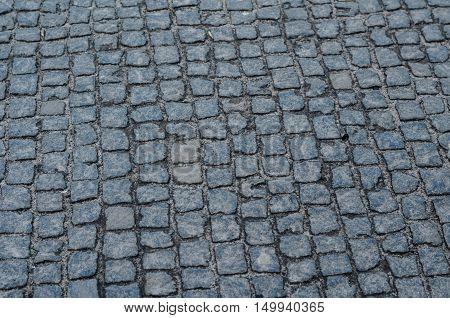 Geometry Pattern Background Of Cobblestone Pavement With Moss