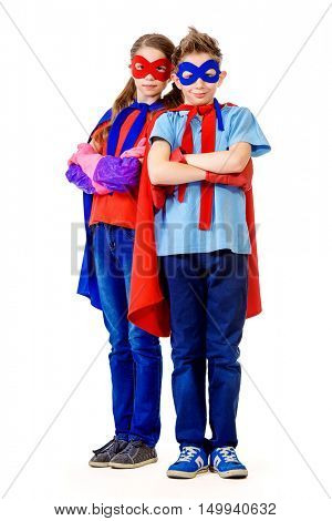 Boy and girl teenagers in a costume of superheroes posing together. Isolated over white background.