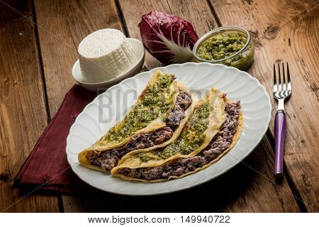 pesto crepes filled with ricotta and chicory