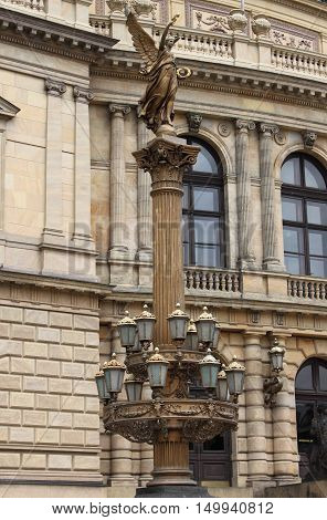 Artistic street lamp in front of the Opera House of Prague, Czech Republic