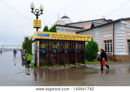 MOGILEV BELARUS - SEPTEMBER 29 2016: Unknown woman goes near self-service terminals