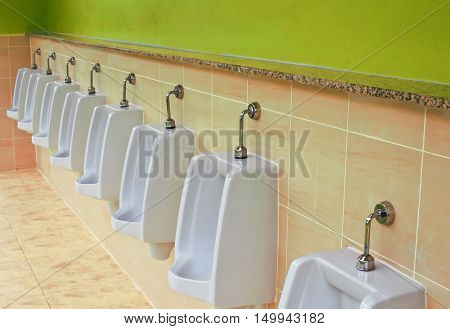 urinals in building for men only for design.