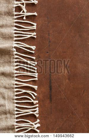 warm wool throw on wooden background
