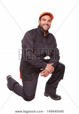 Kneeling Worker In Uniform Isolated On White Background
