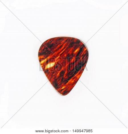 Mediator for a guitar isolated on a white background