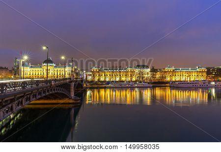 Lyon University bridge along Rhone river at night in Lyon France