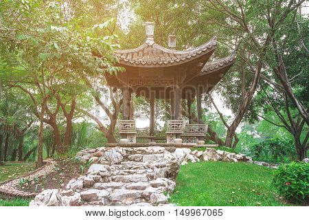 Chinese pavilion with a pleasant atmosphere.Covered with green trees