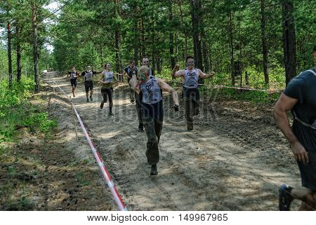 Tyumen, Russia - June 11, 2016: Race of Heroes project on the ground of the highest military and engineering school. Sportsmen run between stages