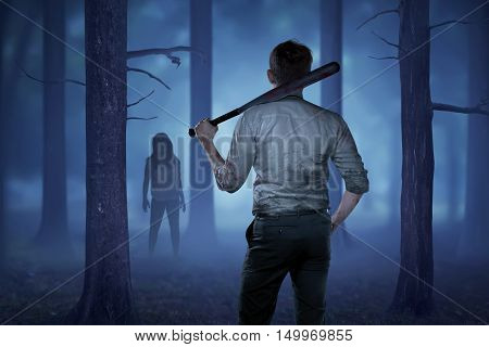 The man in a bloody shirt holding a bloody stick want to hit the lady zombie in front of him