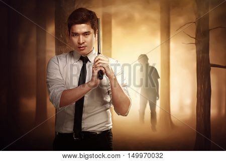 Asian Serious Man With A Formal Shirt And Tie Holding A Gun