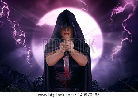 Beautiful Asian Witch With Black Cloak Holding Bloody Knife