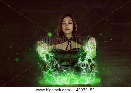 Asian Girl Witch With Red Cloak Preparing A Magic Potion